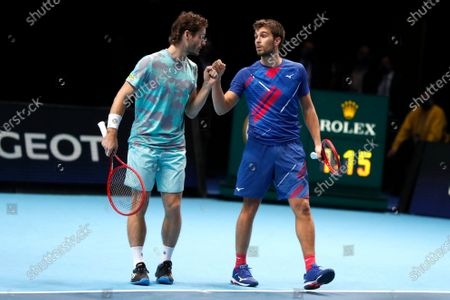 Wesley Koolhof of the Netherlands, left, and Nikola Mektic of Croatia, right, celebrate as they win match point against Jurgen Melzer of Austria and Edouard Roger-Vasselin of France during their doubles final tennis match at the ATP World Finals tennis tournament at the O2 arena in London