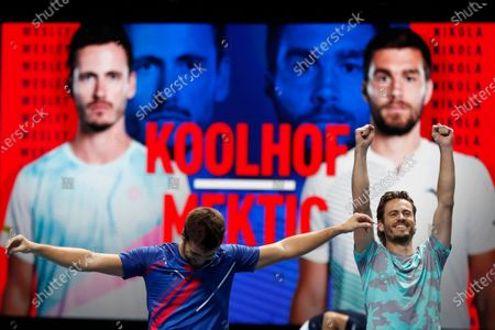 Wesley Koolhof of the Netherlands, right, and Nikola Mektic of Croatia, left, celebrate as they win match point against Jurgen Melzer of Austria and Edouard Roger-Vasselin of France during their doubles final tennis match at the ATP World Finals tennis tournament at the O2 arena in London