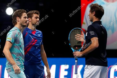 Wesley Koolhof of the Netherlands, left, and Nikola Mektic of Croatia, centre, speak to Edouard Roger-Vasselin of France, right, after winning their doubles final tennis match at the ATP World Finals tennis tournament at the O2 arena in London