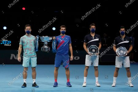Wesley Koolhof of the Netherlands, left, and Nikola Mektic of Croatia, second left, hold up the trophy after winning against Jurgen Melzer of Austria, right, and Edouard Roger-Vasselin of France, second right, during their doubles final tennis match at the ATP World Finals tennis tournament at the O2 arena in London
