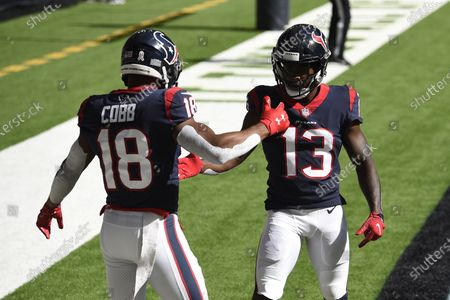 Houston Texans wide receiver Randall Cobb (18) celebrates his touchdown catch with teammate Brandin Cooks (13) during the first half of an NFL football game, in Houston