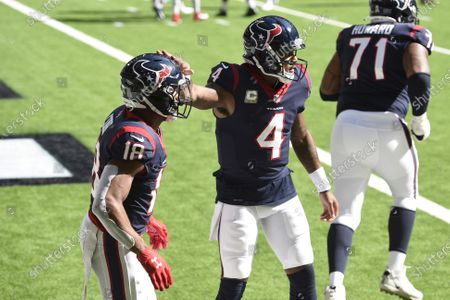 Houston Texans wide receiver Randall Cobb (18) celebrates his touchdown catch with quarterback Deshaun Watson (4) during the first half of an NFL football game, in Houston