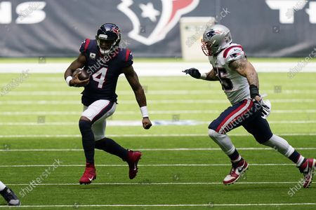 Houston Texans quarterback Deshaun Watson (4) runs past New England Patriots defensive end John Simon (55) during the first half of an NFL football game, in Houston