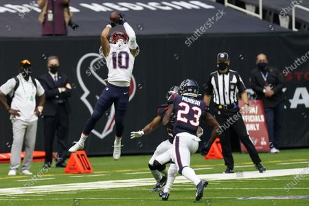 New England Patriots wide receiver Damiere Byrd (10) pulls down a pass over Houston Texans free safety Eric Murray (23) and cornerback Bradley Roby (21) during the second half of an NFL football game, in Houston