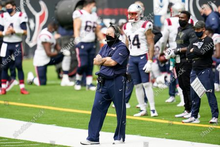 New England Patriots head coach Bill Belichick looks on from the sideline during an NFL football game against the Houston Texans, in Houston