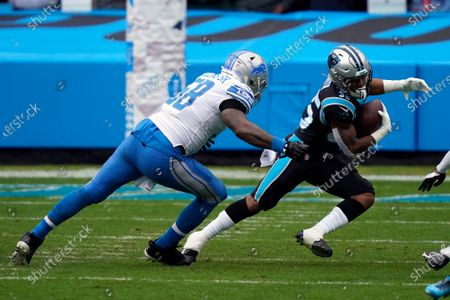 Detroit Lions outside linebacker Jamie Collins (58) chases Caroliona Panthers Rodney Smith (35) during the first half of an NFL football game, in Charlotte, N.C