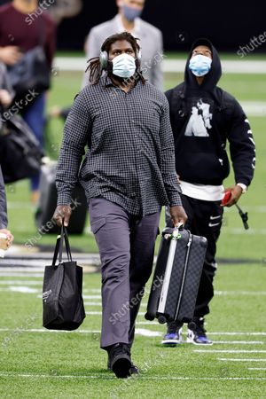 Atlanta Falcons offensive guard James Carpenter (77) walks on the field before an NFL football game against the New Orleans Saints, in New Orleans