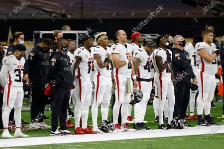 Atlanta Falcons head coach Raheem Morris, wide receiver Julio Jones (11), linebacker Mykal Walker (43), quarterback Matt Schaub (8), fullback Keith Smith (40), and wide receiver Calvin Ridley (18) during the National Anthem before an NFL football game against the New Orleans Saints, in New Orleans