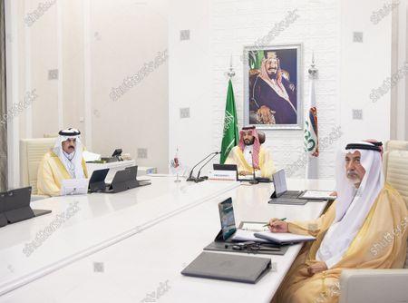 A handout photo made available by G20 Riyadh Summit shows Saudi Arabia's Crown Prince Mohammed bin Salman bin Abdulaziz (C) chairing the final session of the second day of the G20 Riyadh Summit, Riyadh, Saudi Arabia, 22 November 2020. The G20 Leaders' Summit will be held virtually on 21 and 22 November and is organized by Saudi Arabia's current G20 Presidency.