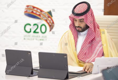 A handout photo made available by G20 Riyadh Summit shows Saudi Arabia's Crown Prince Mohammed bin Salman bin Abdulaziz attending a session of the second day of the G20 Riyadh Summit, Riyadh, Saudi Arabia, 22 November 2020. The G20 Leaders' Summit will be held virtually on 21 and 22 November and is organized by Saudi Arabia's current G20 Presidency.
