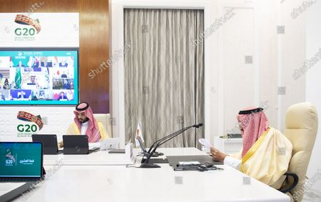Stock Picture of A handout photo made available by G20 Riyadh Summit shows Saudi Arabia's King Salman bin Abdulaziz Al-Saud (R) addressing a session as Crown Prince Mohammed bin Salman bin Abdulaziz (L) attending on the second day of the G20 Riyadh Summit, Riyadh, Saudi Arabia, 22 November 2020. The G20 Leaders' Summit will be held virtually on 21 and 22 November and is organized by Saudi Arabia's current G20 Presidency.
