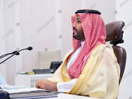 Saudi Arabia's Crown Prince Mohammed bin Salman attends a virtual G-20 summit held over video conferencing, in Riyadh, Saudi Arabia, . The Group of 20 summit began Saturday with appeals by the world's most powerful leaders to collectively chart a way forward as the coronavirus pandemic overshadows this year's gathering