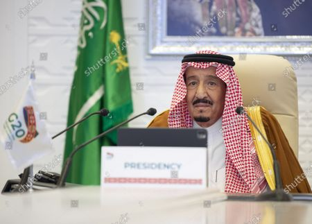 "Saudi Arabian King Salman bin Abdulaziz Al Saud attends the virtual 15th Group of 20 (G20) Leaders' Summit in Riyadh, Saudi Arabia, Nov. 21, 2020. TO GO WITH ""Saudi King calls for reopening economies, borders to facilitate trade, mobility of people"""