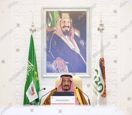 "Saudi Arabian King Salman bin Abdulaziz Al Saud attends the virtual 15th Group of 20 (G20) Leaders' Summit in Riyadh, Saudi Arabia, Nov. 21, 2020. TO GO WITH ""Saudi King calls for reopening economies, borders to facilitate trade, mobility of people"""