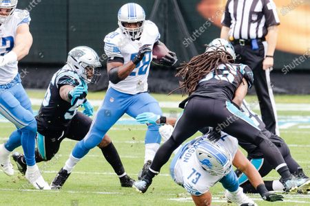 Carolina Panthers linebacker Jermaine Carter (56) reaches for Detroit Lions running back Adrian Peterson (28) in the NFL matchup at Bank of America Stadium in Charlotte, NC