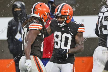 Stock Image of Cleveland Browns wide receiver Jarvis Landry (80) celebrates with running back Kareem Hunt (27) after Hunt scored during the second half of an NFL football game against the Philadelphia Eagles, in Cleveland