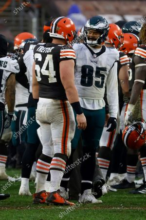 Philadelphia Eagles tight end Richard Rodgers (85) talks with Cleveland Browns center JC Tretter (64) after an NFL football game, in Cleveland
