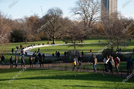 Visitors enjoy the Diana, Princess of Wales Memorial Fountain on a sunny Sunday afternoon in Hyde Park during the second Covid-19 lockdown.