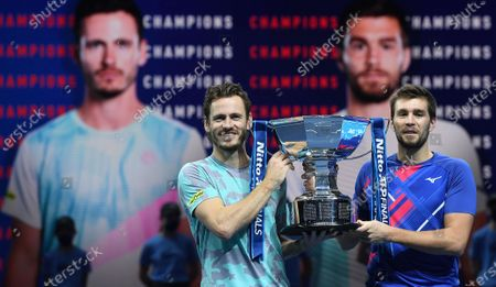Wesley Koolhof (L) of the Netherlands and Nikola Mektic (R) of Croatia celebrate with the trophy after winning their doubles final match against Austria's Jurgen Melzer and France's Edouard Roger-Vasselin at the ATP World Tour Finals tennis tournament in London, Britain, 22 November 2020.