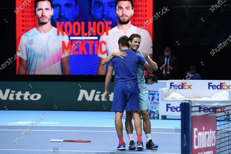 Wesley Koolhof (R) of the Netherlands and Nikola Mektic (L) of Croatia celebrate after winning their doubles final match against Austria's Jurgen Melzer and France's Edouard Roger-Vasselin at the ATP World Tour Finals tennis tournament in London, Britain, 22 November 2020.