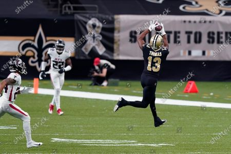 Stock Picture of New Orleans Saints wide receiver Michael Thomas (13) pulls in a pass reception in the first half of an NFL football game against the Atlanta Falcons in New Orleans, . During the first half, Thomas moved ahead of Jarvis Landry for the most catches in first five years in the NFL