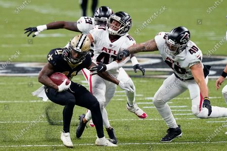 New Orleans Saints Deonte Harris (11) returns a punt against Atlanta Falcons Sharrod Neasman (41), Keith Smith (40) and LaRoy Reynolds (59) in the first half of an NFL football game in New Orleans