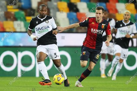 Udinese's Samir (L) and Genoa's Lukas Lerager in action during the Italian Serie A soccer match Udinese Calcio vs Genoa CFC at the Friuli - Dacia Arena stadium in Udine, Italy, 22 November 2020.