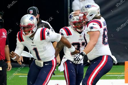 New England Patriots running back Damien Harris (37) celebrates with teammates Cam Newton (1) and David Andrews (60) after scoring a touchdown against the Houston Texans during the first half of an NFL football game, in Houston
