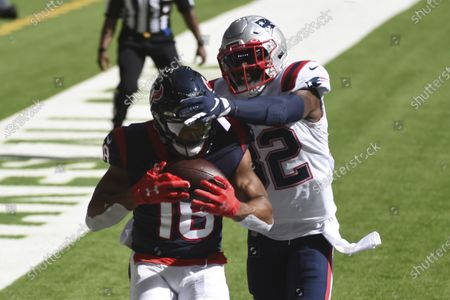 Stock Photo of Houston Texans wide receiver Randall Cobb (18) catches a pass for a touchdown in front of New England Patriots free safety Devin McCourty (32) during the first half of an NFL football game, in Houston