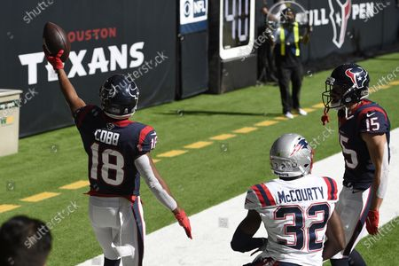 Stock Image of Houston Texans wide receiver Randall Cobb (18) celebrates his touchdown catch in front of New England Patriots free safety Devin McCourty (32) during the first half of an NFL football game, in Houston