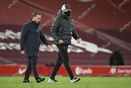Manager Juergen Klopp (R) of Liverpool and manager Brendan Rodgers of Leicester walk off the pitch after the English Premier League soccer match between Liverpool FC and Leicester City in Liverpool, Britain, 22 November 2020.