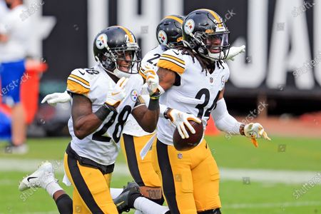 Pittsburgh Steelers safety Terrell Edmunds (34) celebrates with teammates cornerback Mike Hilton, left, and linebacker Marcus Allen, bak center, after intercepting a pass against the Jacksonville Jaguars during the first half of an NFL football game, in Jacksonville, Fla