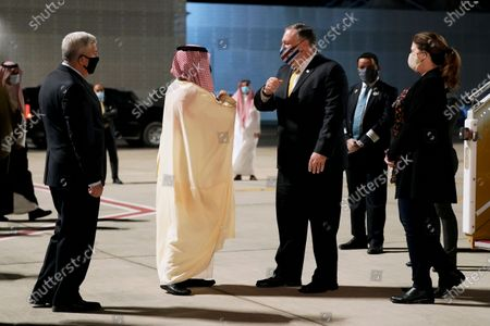 Ambassador to Saudi Arabia John Abizaid, left, and Saudi Arabia's Foreign Minister Faisal bin Farhan, second from left, greet Secretary of State Mike Pompeo and his wife Susan as they arrive at Neom Bay Airport in Neom, Saudi Arabia, . Secretary Pompeo is in Saudi Arabia to meet with Crown Prince Mohammed bin Salman