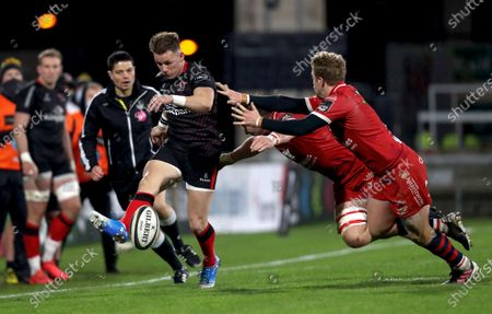 Ulster vs Scarlets. Ulster's Craig Gilroy is tackled by Ed Kennedy and Angus O'Brien of Scarlets