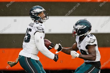 Philadelphia Eagles tight end Richard Rodgers, left, celebrates with wide receiver Jalen Reagor after scoring a 19-yard touchdown during the second half of an NFL football game against the Cleveland Browns, in Cleveland