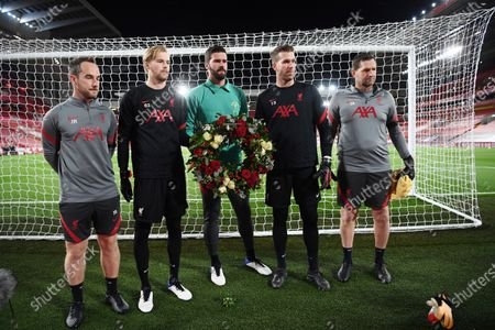 Liverpool's goalkeepers and their trainers pay tribute to former England goalkeeper Ray Clemence, who died on 15 November, before the English Premier League soccer match between Liverpool and Leicester City at Anfield stadium in Liverpool, England
