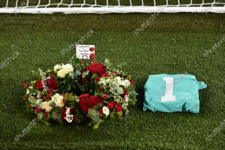 Flowers and a shirt lay behind the gates in a memory of England goalkeeper Ray Clemence, who died on 15 November, before the English Premier League soccer match between Liverpool and Leicester City at Anfield stadium in Liverpool, England
