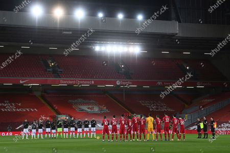 Stock Photo of Teams and referees attend a minute of silence in a memory of England goalkeeper Ray Clemence, who died on 15 November, before the English Premier League soccer match between Liverpool and Leicester City at Anfield stadium in Liverpool, England