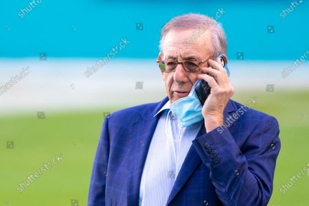 Miami Dolphins Chairman of the Board/Managing General Partner Stephen Ross talks on his cellphone on the field before the Dolphins take on the Los Angeles Chargers during an NFL football game, in Miami Gardens, Fla