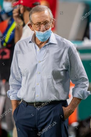 Miami Dolphins Chairman of the Board/Managing General Partner Stephen Ross wears a mask on the field after the Dolphins defeated the Los Angeles Chargers during an NFL football game, in Miami Gardens, Fla
