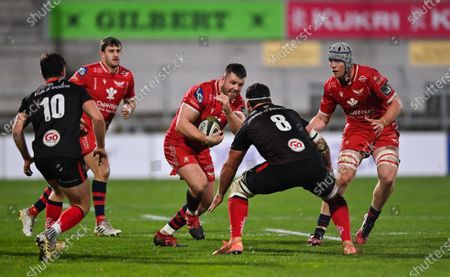 Rob Evans of Scarlets in action against Marcell Coetzee of Ulster