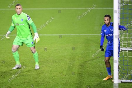 Stock Image of Genk's goalkeeper Daniel Danny Vukovic and Genk's Theo Bongonda pictured during a soccer match between KRC Genk and RE Mouscron, Sunday 22 November 2020 in Genk, on day 13 of the 'Jupiler Pro League' first division of the Belgian championship.