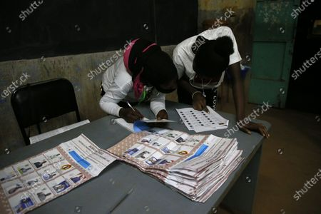 Election workers start the counting of the ballots after voting closed during the first round of the presidential election, in Ouagadougou, Burkina Faso, 22 November 2020. Polls opened on 22 November for Burkina Faso presidential elections, in which the incumbent Roch Marc Christian Kabore is expected to secure a second mandate. Some 6,5 million people are eligible to vote in the race that pits Kabore, 63, against main challenger Zephirin Diabre, 61.