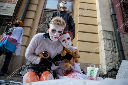 Protesters wearing white masks covered with fake blood symbolising the suffering of the victims take part during the demonstration.Hundreds of people protested on Kanoniczna Street in Cracow. The protest was an aftermath of a recently released reportage 'Don Stanislao. The second face of cardinal Dziwisz' that indicated that cardinal Dziwisz, long-time aide of pope John Paul II, could be responsible for covering up cases of pedophilia among catholic priests. People gathered on the street demanding explanations from the church and expressed support for the victims of pedophilia.