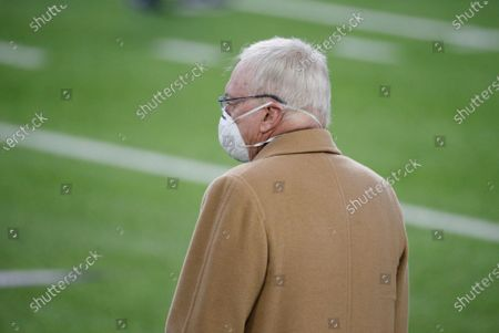 Dallas Cowboys owner Jerry Jones stands on the field before an NFL football game against the Minnesota Vikings, in Minneapolis