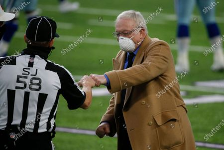 Stock Photo of Dallas Cowboys owner Jerry Jones, right, fits bumps side judge Don Willard, left, before an NFL football game against the Minnesota Vikings, in Minneapolis