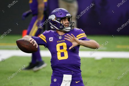 Minnesota Vikings quarterback Kirk Cousins warms up before an NFL football game against the Dallas Cowboys, in Minneapolis