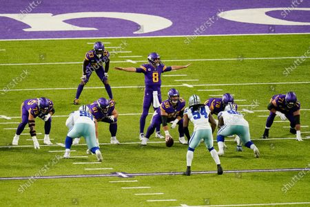 Minnesota Vikings quarterback Kirk Cousins (8) signals teammates at the line of scrimmage during the first half of an NFL football game against the Dallas Cowboys, in Minneapolis