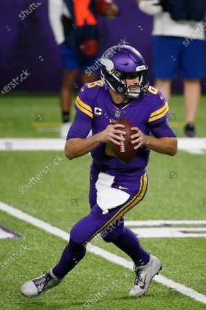 Minnesota Vikings quarterback Kirk Cousins looks to pass during the second half of an NFL football game against the Dallas Cowboys, in Minneapolis