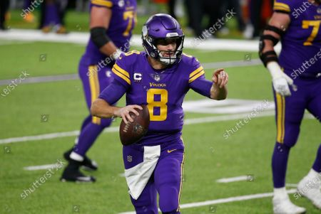 Minnesota Vikings quarterback Kirk Cousins scrambles up field during the second half of an NFL football game against the Dallas Cowboys, in Minneapolis